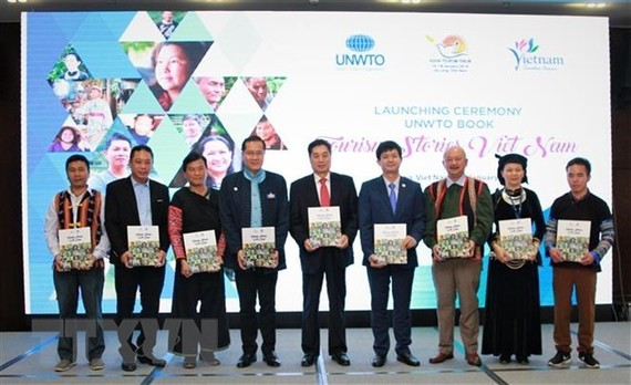 """At the launching ceremony of the """"Tourism Stories-Vietnam Edition"""" (Photo: VNA)"""