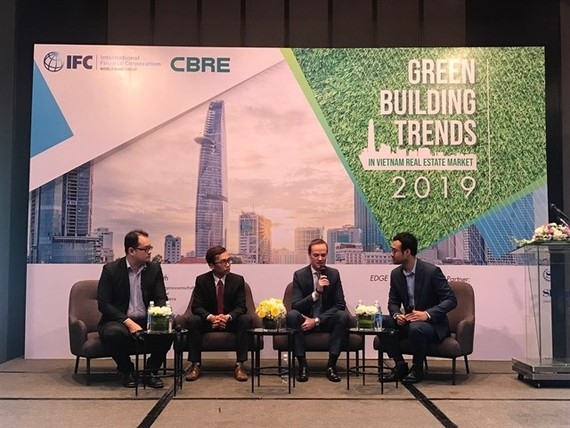 A panel discussion at a conference on green building in HCM City where experts stressed the benefits of adopting such standards. (Photo: VNA)