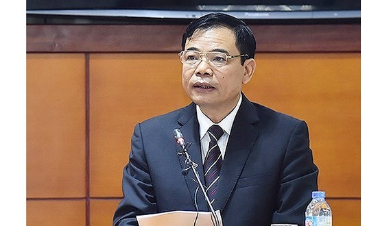 Minister Cuong speaks at the National Assembly session (Photo: SGGP)