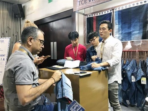 A booth at the Denims and jeans Vietnam exhibition. The denim production sector has high growth potential and is seeing more and more investors, experts say. - VNA Photo My Phương