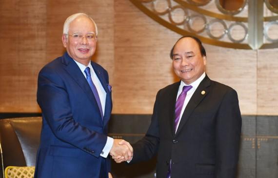 Vietnamese Prime Minister Nguyen Xuan Phuc (R) and Malaysian Prime Mininster Najib Tun Razak (Photo: VGP)