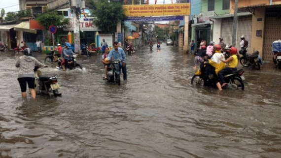 A two- hour downpour floods the city roads