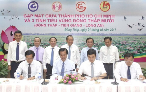 A meeting to economic cooperation and development between Dong Thap, Long An and Tien Giang with Ho Chi Minh City.