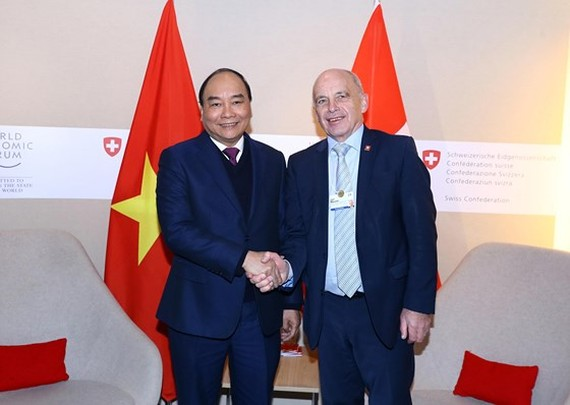 Vietnamese Prime Minister Nguyen Xuan Phuc and Swiss President Ueli Maurer at WEF Davos 2019 (Photo:VNA)