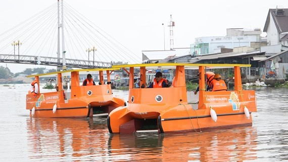 Two solar powered boats to overcome the water pollution caused by floating trash in the river.