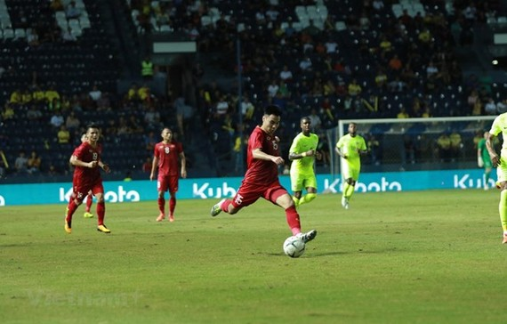 Midfielder Duc Huy (No. 15) equalised for Vietnam at the 83rd minute (Photo: VNA)