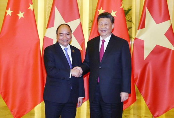 政府總理阮春福會見中國主席習近平。(圖源:越通社)