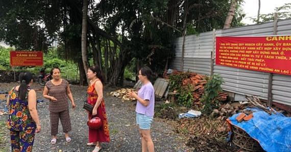 被騙賣位於平新郡安樂坊林宏街李昭皇公寓邊的地段的受害者們。