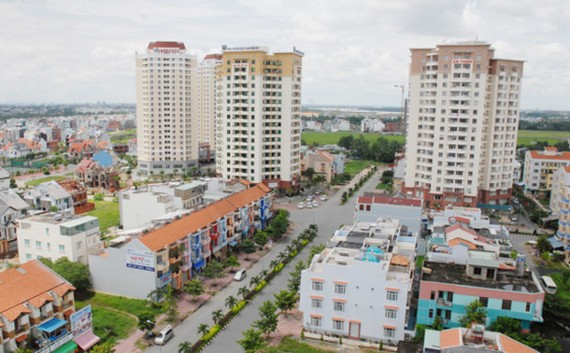 Real estate businesses' registered capital highly increases in HCMC during the first four months this year (Photo: SGGP)