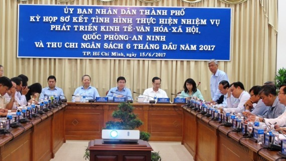 A view of the meeting chaired by HCMC chairman Nguyen Thanh Phong to review economic, social and cultural conditions in the first half this year on June 14 (Photo: SGGP)