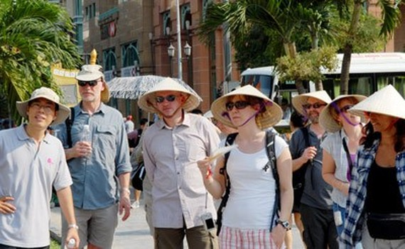 Foreign visitors in HCMC (Photo: SGGP)