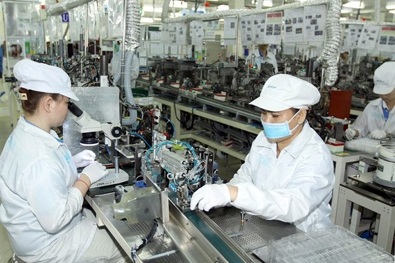 Manufacturing electronic components at the Japan-based Nidec Sankyo Ltd Co in the Saigon Hi-tech Park in HCM City. (Photo: VNA/VNS)