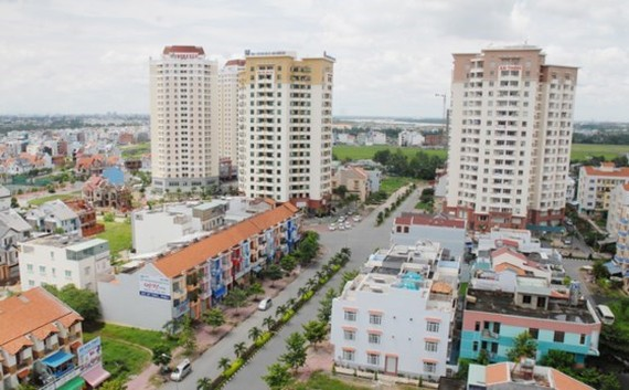 HoREA has proposed to change some articles of the Land Law 2013 to solve congestions for the real estate market (Photo: SGGP)