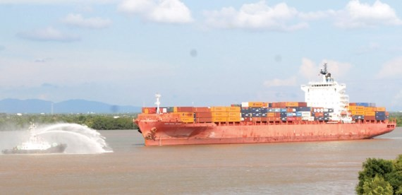 A seagoing vessel travels to HCMC by waterway (Photo: SGGP)