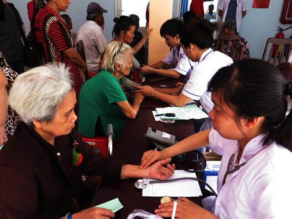 Senior citizens receive health checks in District 8, HCM City. (Photo: VNA/VNS)