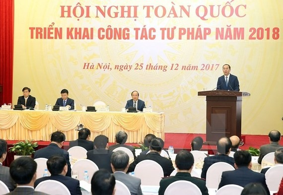 President Tran Dai Quang speaks at a meeting held by the Ministry of Justice yesterday to review its performance over the past year and set tasks for 2018. (Photo: VNA/VNS)