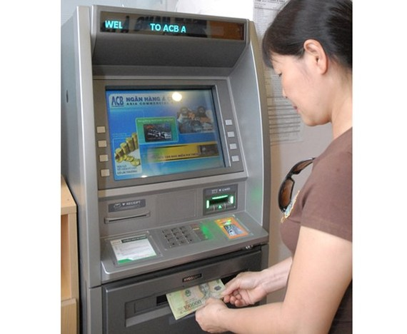 Banks must ensure ATMs to operate smoothly and safely during the Tet holiday (Photo: SGGP)