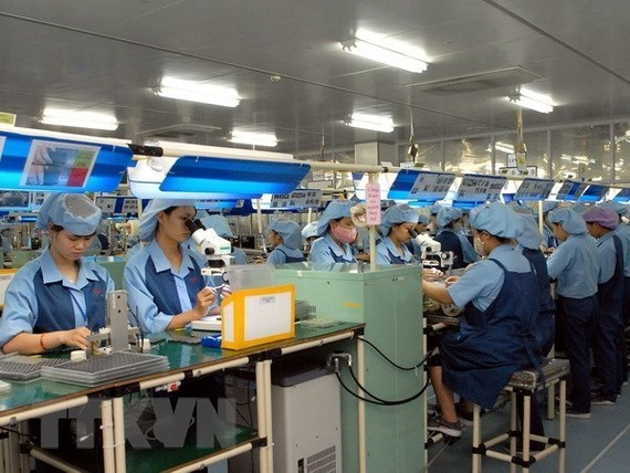 Workers at an electronic spare part manufacturing plant in Vietnam (Source: VNA)