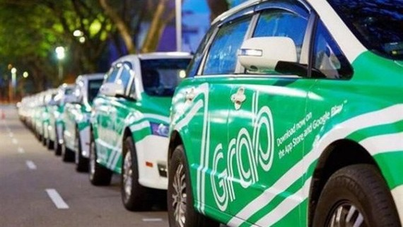 The HCMC court on Friday ordered Grab to pay US$210,300 to local taxi firm Vinasun for its violations during 2016-17, which caused losses for the Vietnamese firm. (Photo: vneconomy.vn)