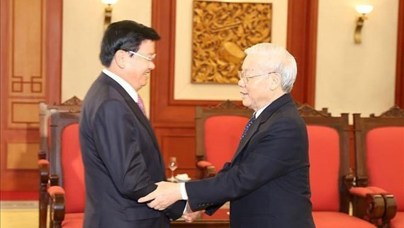 General Secretary of the Communist Party cum President of Vietnam Nguyen Phu Trong receives Prime Minister Thongloun Sisoulith