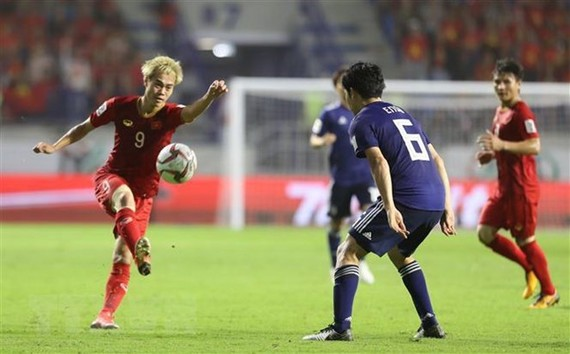 Vietnamese players (in red) (Source: VNA)