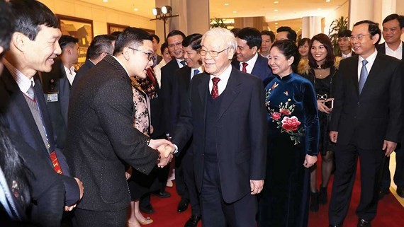 Party General Secretary Nguyen Phu Trong and overseas Vietnamese at Homeland Spring Program 2019 (Photo: VNA)