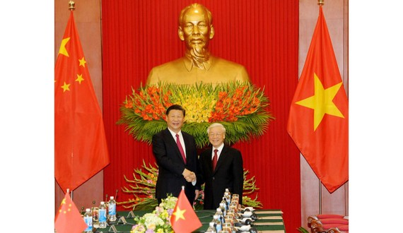 Party General Secretary and President Nguyen Phu Trong (right) and his Chinese counterpart Xi Jinping (Photo: VGP)