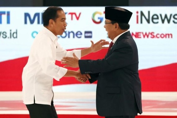 Presidential candidates Joko Widodo (left) and Prabowo Subianto shake hands during a debate among candidates in Jakarta, Indonesia, on Feb 17, 2019. (Source: EPA-EFE)