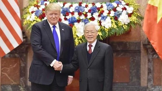General Secretary of the Communist Party of Vietnam Central Committee and President Nguyen Phu Trong (right) and US President Donald Trump (Photo: SGGP)