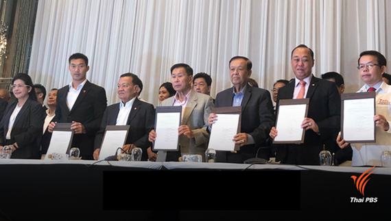 "Leaders of six political parties which have formed the Pheu Thai-led alliance to set up a coalition government display a joint statement confirming their commitment to ""end the power of NPCO"" during a press conference on March 27. (Source: thaipbsworld.co"