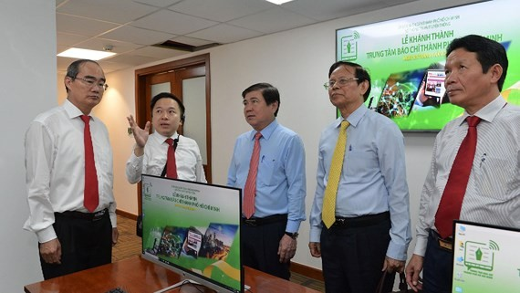 HCMC leaders visit HCMC Press Center that officially comes into operation on May 5 (Photo: SGGP)