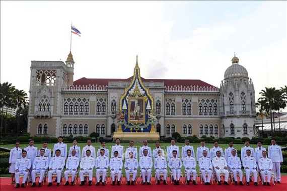 New cabinet members of Thailand led by Prime Minister Prayut Chan-o-cha have been sworn in on July 16. (Photo: AFP/VNA)