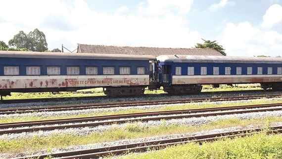 A corner of Kep station in Lang Giang, Bac Giang province with old coaches and rails