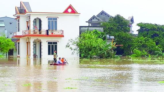 Nước ngập tại xã Thiệu Dương (TP Thanh Hóa, tỉnh Thanh Hóa). Ảnh: DUY CƯỜNG