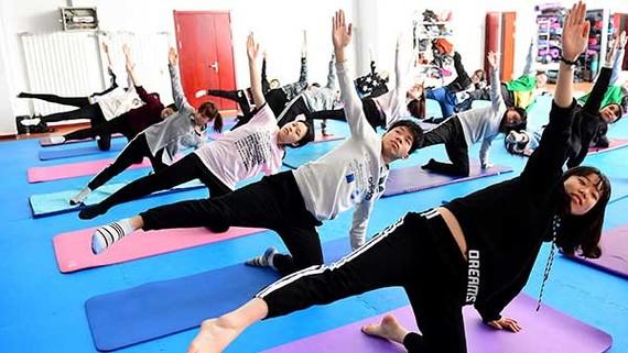 Mở trường yoga khắp Trung Quốc