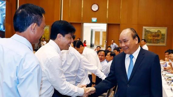 Thủ tướng  Nguyễn Xuân Phúc, Chủ tịch Ủy ban Quốc gia Chính phủ điện tử  và các đại biểu  dự hội nghị. Ảnh: TTXVN