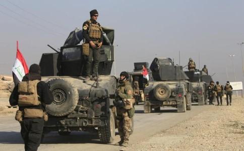 Binh sĩ Iraq tiến vào Mosul. Ảnh: REUTERS
