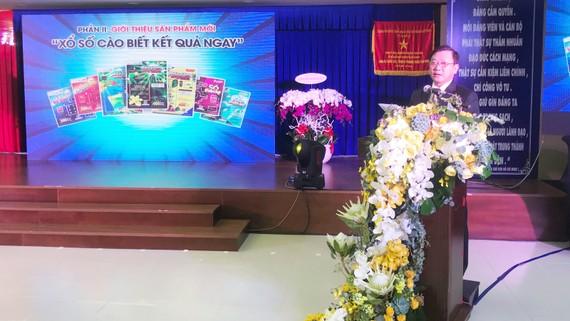 Ông Đỗ Quang Vinh giới thiệu loại hình xổ số mới. Ảnh: ĐỖ DOÃN