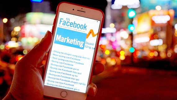 Quảng cáo trên Facebook ở Việt Nam thu lợi lớn nhưng không nộp thuế      Ảnh: HOÀNG HÙNG