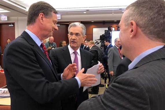 Federal Reserve Chairman Jerome Powell (C) speaks with Chicago Fed President Charles Evans (L) and St Louis Fed President James Bullard at a conference on monetary policy at the Federal Reserve Bank of Chicago, part of a 'Fed Listens' series as the U.S. c