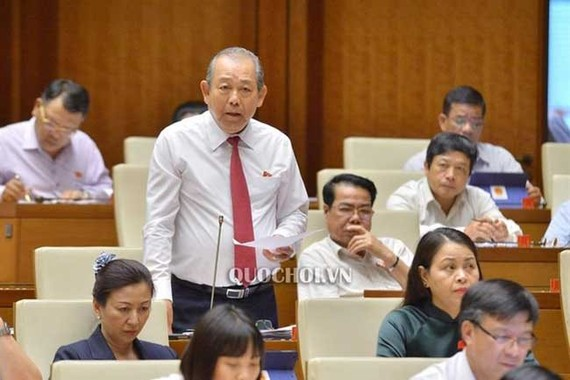 Deputy Prime Minister Truong Hoa Binh speaks at a question-and-answer session at the National Assembly' today, June 4 - PHOTO: QUOCHOI.VN