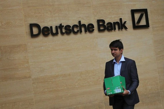 A man carrying a box leaves a Deutsche Bank office in London on Monday. PHOTO: SIMON DAWSON/REUTERS