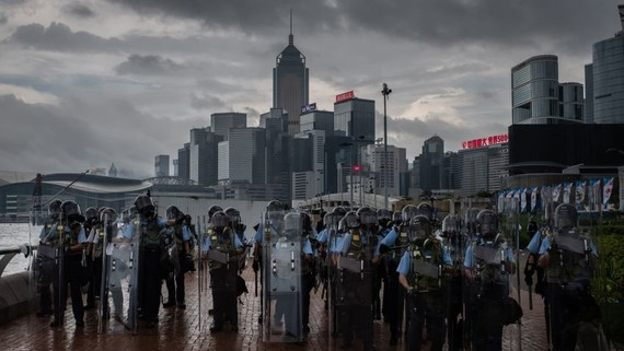 Riot police blocks part of the promenade on Victoria Harbor Central on June 12: breaking up property monopolies is a good first step to narrow the rich-poor divide.   © LightRocket/Getty Images
