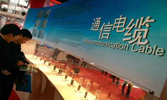 Visitors look at telecommunication cable displayed at an exhibition in Beijing, China on Oct. 24, 2007. (Teh Eng Koon/AFP/Getty Images)