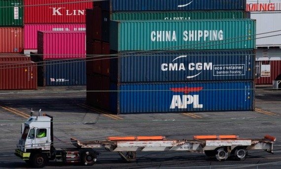 A truck passes by shipping containers at the Port of L.A., in Long Beach, Calif., on Sept. 1, 2019. (Mark Ralston/AFP/File Photo via Getty Images)