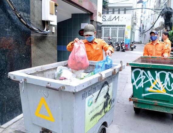 Thu gom rác tại nguồn       Ảnh: CAO THĂNG