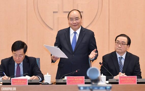 Thủ tướng Nguyễn Xuân Phúc phát biểu tại buổi làm việc giữa Ban Cán sự Đảng Chính phủ với Ban Thường vụ Thành ủy Hà Nội. Ảnh: VGP