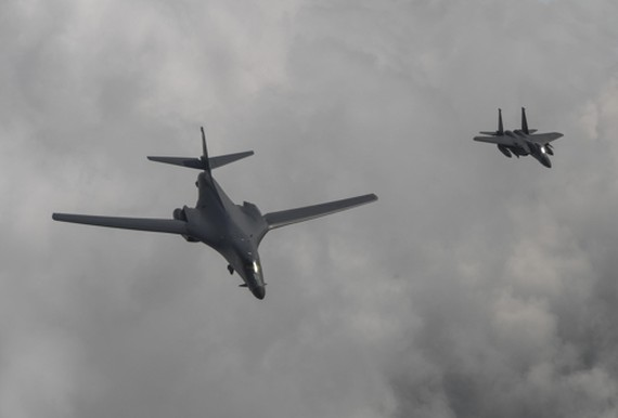 A U.S. B-1B bomber (L) flies over Korea along with a South Korean F-15K fighter on July 30, 2017 in this photo provided by the Air Force. (Yonhap)