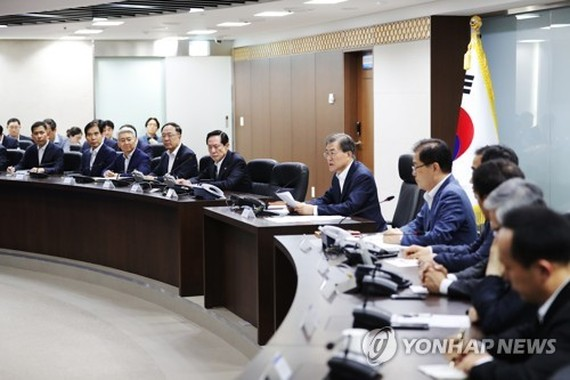 This file photo released by Cheong Wa Dae on July 29, 2017, shows President Moon Jae-in (C) presiding over an emergency meeting of the National Security Council. (Yonhap)