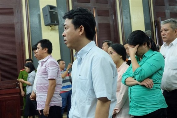 Defendants at the court hearing. — Photo plo.vn